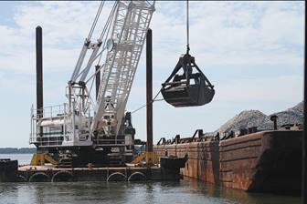 A crane moves substrate to help rebuild part of a reef on VA's Great Wicomico River. (U.S. Army Corps of Engineers)